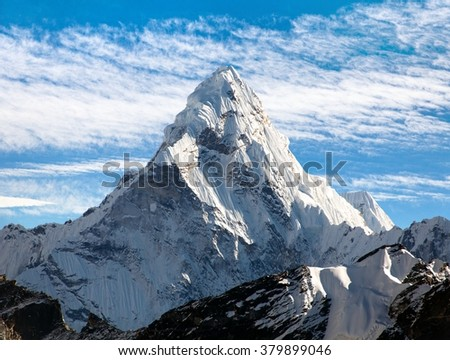 View of Ama Dablam on the way to Everest Base Camp with beautiful cloudy sky, Sagarmatha national park, Khumbu valley, Nepal