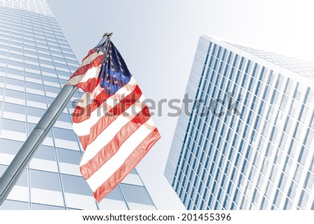 View of American flag on blue building background - stock photo