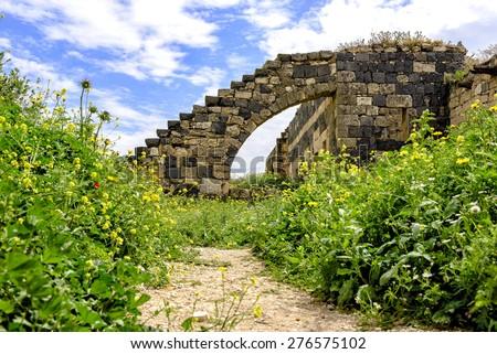 View of an ancient roman wall in Umm Qais, Jordan - Umm Qais is the site of the Hellenistic-Roman town of Gadara, and the ancient walls may now be traced in almost their entire circuit of 3 km.  - stock photo