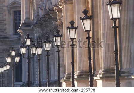 View of an array of lampposts lining a sidewalk, Paris, France,