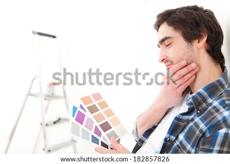 View of an Attractive man choosing the color of his new flat