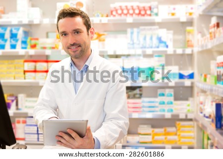 View of an attractive pharmacist at work