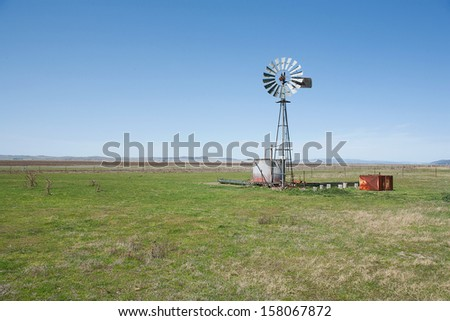 View of an Australian Windmill situated in a farm paddock