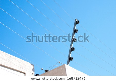 View of an electric fence installation on a concrete wall - stock photo