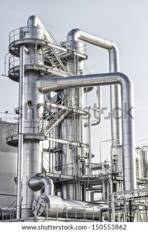 View of an industrial oil refinery with shiny tubes.
