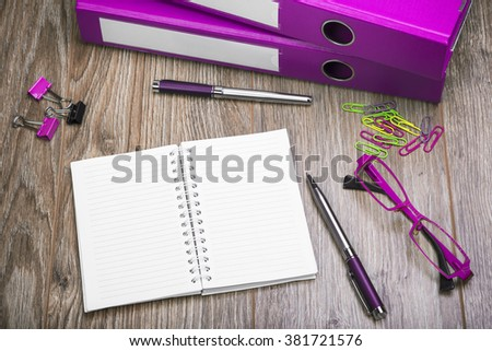 View Of An Office Desk With Ring Binders, Cell Phone, Empty Sheets Of Paper And Pen. Office Desk In Retro Style. - stock photo