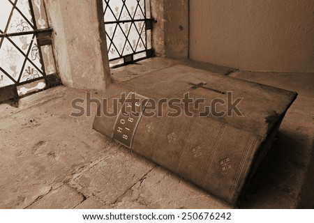 View of an Old Bible in a Church  - stock photo
