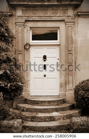 View of an Old House Front Door in Sepia - stock photo