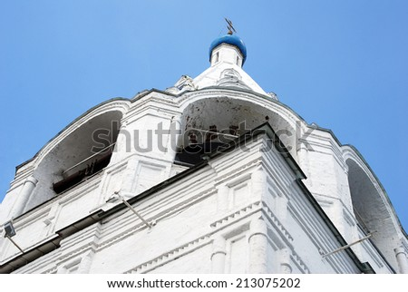 View of an old orthodox bell tower. Kremlin in Kolomna, Moscow region, Russia. Popular touristic landmark, place for walking and historic place. Low angle view. - stock photo
