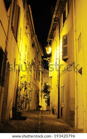 View of an Old Town street of Cannes at night. France - stock photo