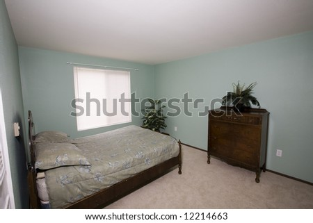 View of an ordinary bedroom in a condominium - stock photo