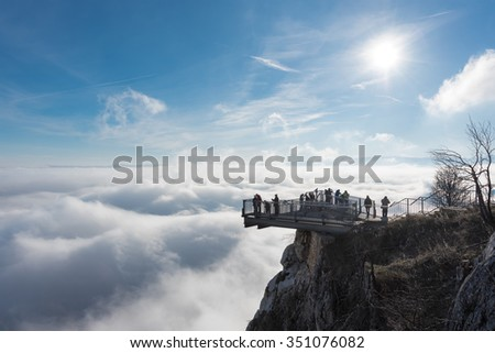 View of an Skywalk high above a smokescreen in front of blue sky in Lower Austria - stock photo