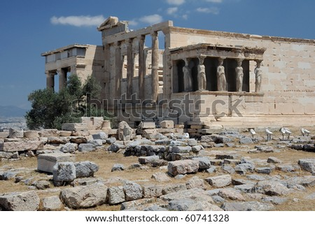View of ancient Greek temple Erechtheion with the Porch of the Caryatids in Athens, Greece.