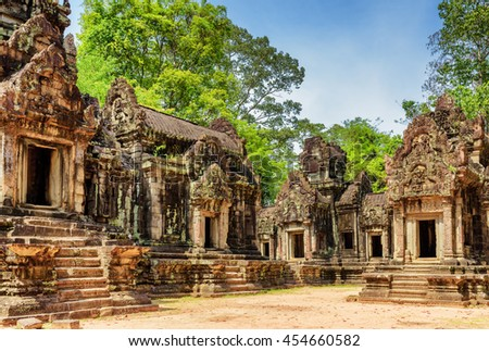 View of ancient Thommanon temple in amazing Angkor, Siem Reap, Cambodia. Mysterious Thommanon nestled among rainforest. Blue sky in background. Enigmatic Angkor is a popular tourist attraction.