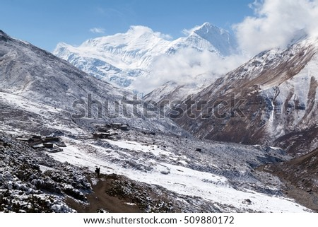 View of Annapurna III and Gangnapurna from Jharsang Khola valley near Yak Kharka on Round Annapurna trek (Annapurna Circuit) in Himalaya mountains, Annapurna Conservation Area, Manang, Nepal.