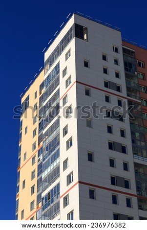 View of apartment building on the sky background - stock photo