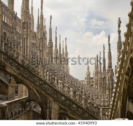 View of architectural detail of Duomo di Milano roofs - stock photo