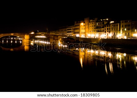 View of Arno River by Night in Florence.