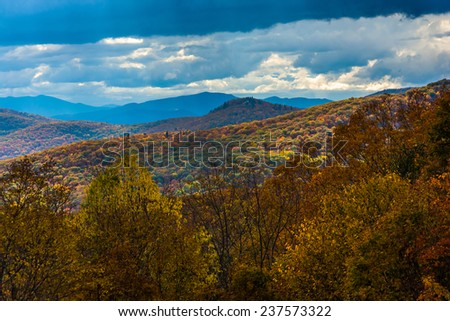 View of autumn color from the Blue Ridge Parkway, near Blowing Rock, North Carolina. - stock photo