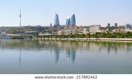 View of Baku downtown with Flame Towers skyscrapers and TV tower from Caspian Sea, Azerbaijan - stock photo