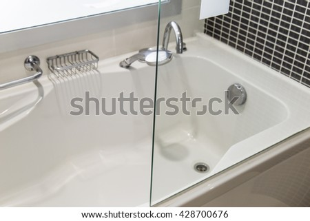 View of bath tube with day light from the window, very shallow depth of field