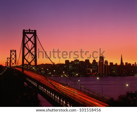 View of Bay Bridge from Treasure Island at sunset, San Francisco, California - stock photo