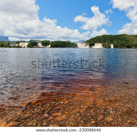 View of beach and four waterfalls in the lagoon of Canaima national park - Venezuela - stock photo