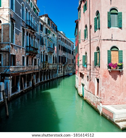 View of beautiful colored Venice canal with houses standing in water, Italy - stock photo