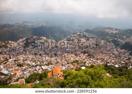 View of beautiful historic town of Taxco de Alarcon, Guerrero, Mexico. - stock photo