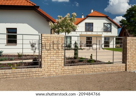 View of beautiful house with modern fence