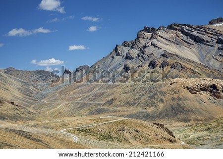 View of beautiful mountains and winding road - stock photo