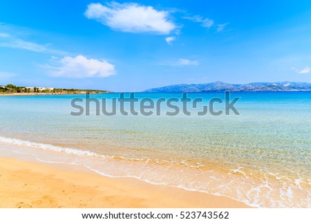 View of beautiful sandy Santa Maria beach with azure sea water on coast of Paros island, Greece