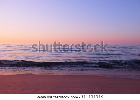 View of beautiful sunrise on the beach  - stock photo