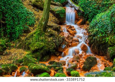 View of beautiful waterfall in the Czech-Saxony Switzerland. - stock photo