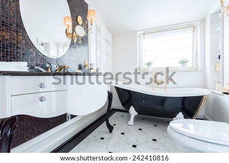 View of black and white baroque bathroom - stock photo