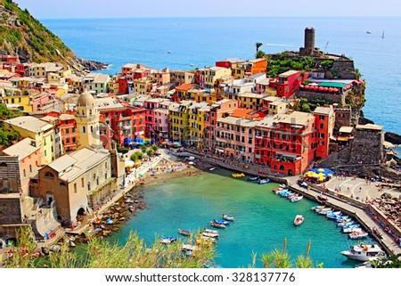 View of blue harbor and old houses in Vernazza, Cinque Terre, Ligurian province, Italy - stock photo
