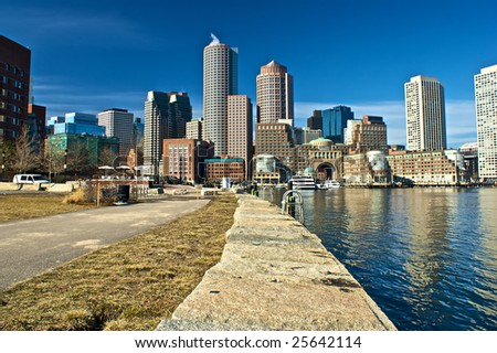 view of boston from harbor and rowes wharf and skyscraper buildings in boston massachusetts - stock photo