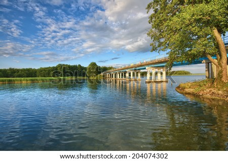 View of bridge on beautiful lake before sunset, Mazury, Poland