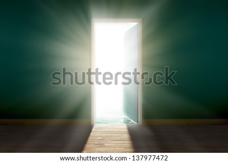 View of bright, blinding sun, seen through an open door. - stock photo