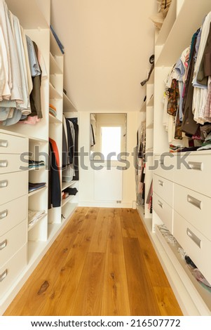 View of bright spacious closet in modern house - stock photo