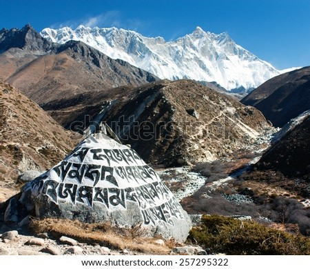 View of Buddhist symbols on the stone round the Orsho village and mount Lhotse - way to Everest base camp - Sagarmatha national park - Nepal - stock photo