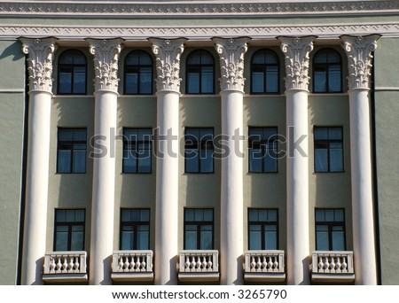 View of  building with white columns and Soviet symbols
