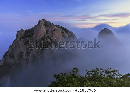 View of  bukhansan national park. sunrise morning and covered by heavy fog. national park in seoul, south korea.
