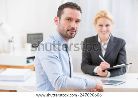 View of 2 Business man finalising agreement at the office - stock photo