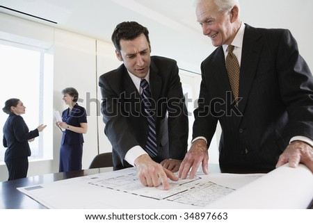 View of businesspeople planning in an office. - stock photo