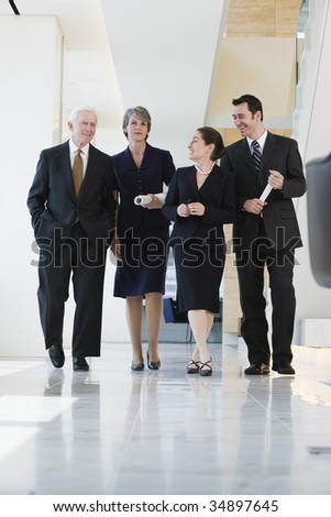 View of businesspeople walking in a corridor.