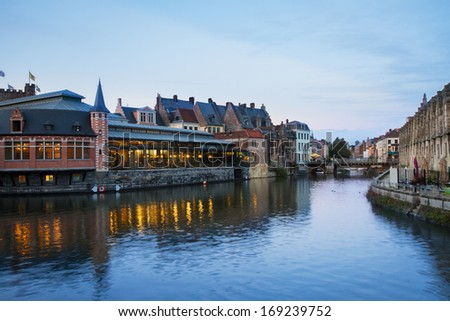 View of canal and old buildings at night, Ghent, Belgium - stock photo