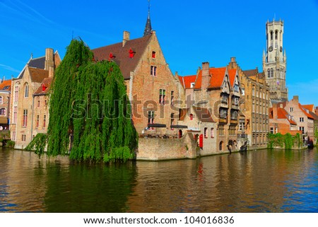 View of canal, belfry and houses at Bruges, Belgium - stock photo