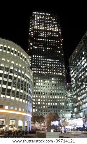 View of Canary Wharf skyscrapers in London at night - stock photo