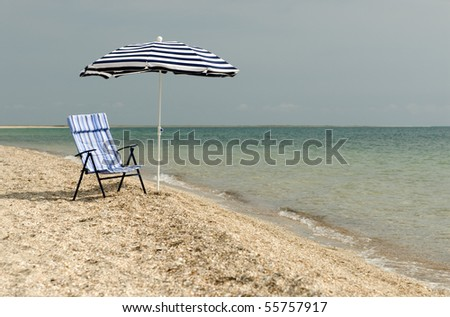 view of  chair and umbrella on the beach - stock photo